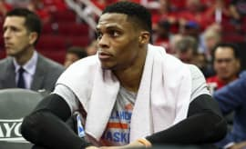 Russell Westbrook sits on the bench during Game 2 of the Thunder/Rockets playoff series.