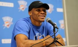 Russell Westbrook speaks at a press conference.
