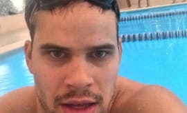 Kris Humphries swimming in a pool.