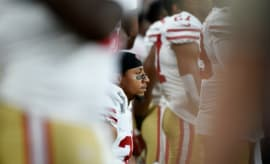 Eric Reid takes a knee during the national anthem before a preseason game.