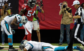 Cam Newton (1) lays on the field as running back