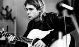 This is Kurt Cobain playing guitar.