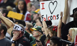 Atlanta Falcons fans in Georgia Dome raise their signs.