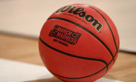 Basketball with NCAA branding.