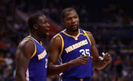 Kevin Durant #35 of the Golden State Warriors talks with Draymond Green #23
