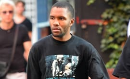 Frank Ocean walks down the street.