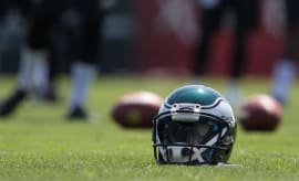 Eagles helmet sits on the field.
