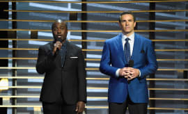 Marshall Faulk and Kurt Warner speak onstage at A+E Networks 'Shining A Light' concert