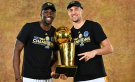 Draymond Green and Klay Thompson celebrate the Warriors' NBA title.