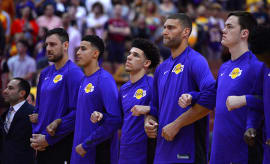 Los Angeles Lakers lock arms during the national anthem