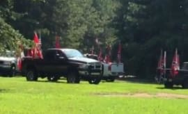 Couple shows off Confederate flags on their pick-up truck.