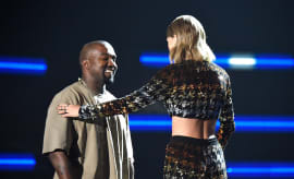 Kanye West and Taylor Swift greet one another.