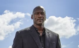 Michael Jordan in a suit in front of a blue sky