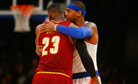 Carmelo Anthony hugs LeBron James after a game.