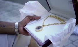 Isaiah Thomas gives his dad a chain.