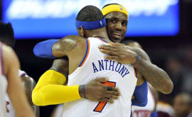 LeBron James and Carmelo Anthony hug one another.