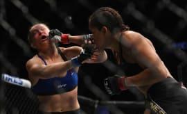 Amanda Nunes punches Ronda Rousey.