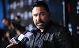 Oscar De La Hoya answers questions during a press conference.