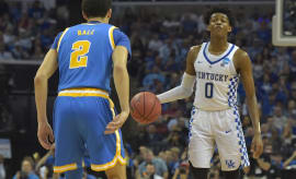 Lonzo Ball guards De'Aaron Fox during Kentucky/UCLA game.
