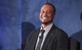 Tiger Woods laughs at a Tiger Woods Foundation event.