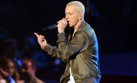 Rapper Eminem performs onstage at the 2014 MTV Movie Awards