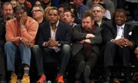 James Dolan sits with former Knicks stars.