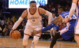 Russell Westbrook drives against the 76ers.