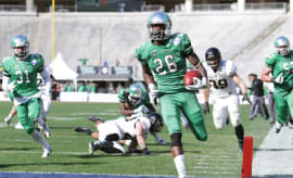 North Texas running back Jeffrey Wilson takes a break from puking to score TD.