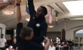 DeMarre Carroll dunks over a midshipman.