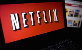 The Netflix Inc. website and logo are displayed on laptop computers