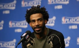 Mike Conley speaks with reporters after a playoff game.