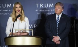 Ivanka Trump delivers a speech as Donald Trump looks on.