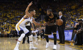 Steph Curry guards Kyrie Irving during NBA Finals.