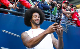 Colin Kaepernick takes a selfie with a 49ers fan.