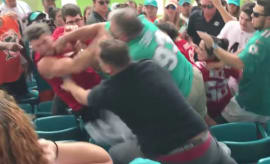 Dolphins fans gang up on a 49ers fan.