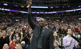 Former Raptor Charles Oakley acknowledges the crowd.