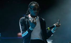 Quavo flips the bird.