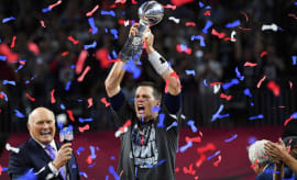 Tom Brady raises Lombardi Trophy following Patriots' Super Bowl LI victory.