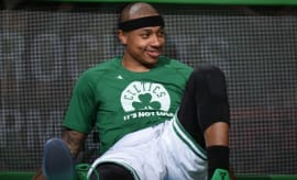 Isaiah Thomas sits on the sideline.