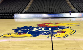 Kansas Jayhawks logo as it appears on a basketball court.