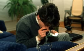 Man snorting cocaine.