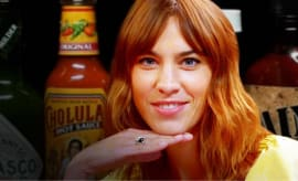 alexa chung fears for her life while eating spicy wings hot ones