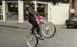 Marshawn Lynch pops a wheelie as he heads towards a bus in London.