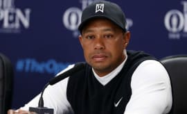 Tiger Woods answers questions at a press conference.