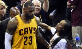 LeBron James passes by his mom Gloria during game.