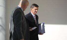 Michael Flynn (R) walks down the West Wing Colonnade