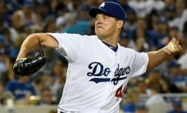 Rich Hill tossed a perfect game through seven innings against the Marlins.