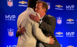 Roger Goodell and Tom Brady hug in 2015.