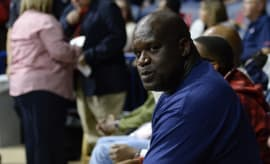 Shaquille O'Neal poses for photo while in the stands.