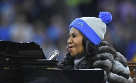 Aretha Franklin sings the National Anthem prior to the Lions-Vikings Thanksgiving game.